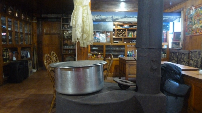 Inside one of the larger tea houses with the traditional Yak dung stove